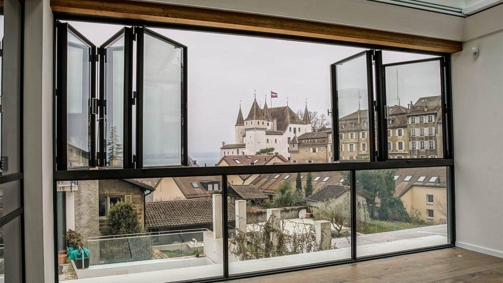 Looking outside at a castle Nyon, Geneva through open MHB folding door