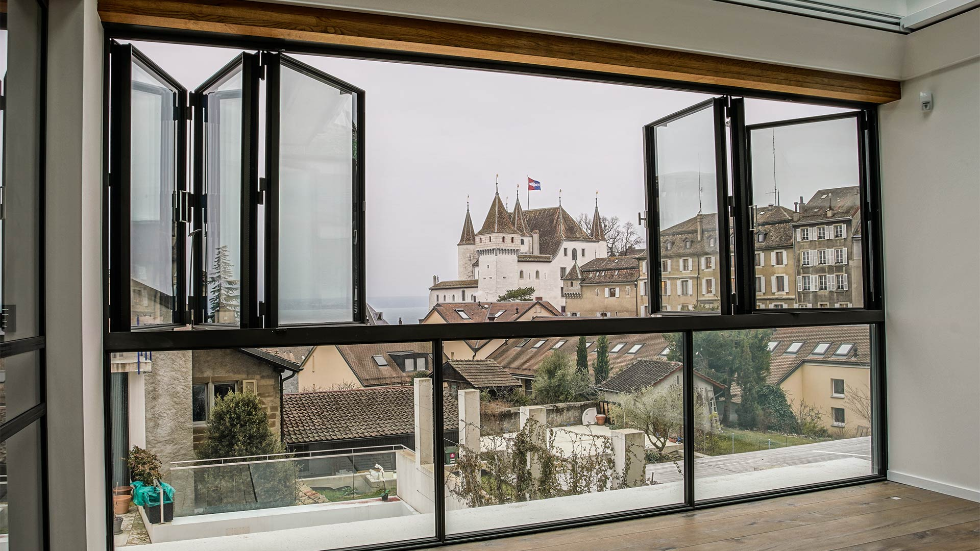 Looking outside at a castle Nyon, Geneva through open MHB folding door