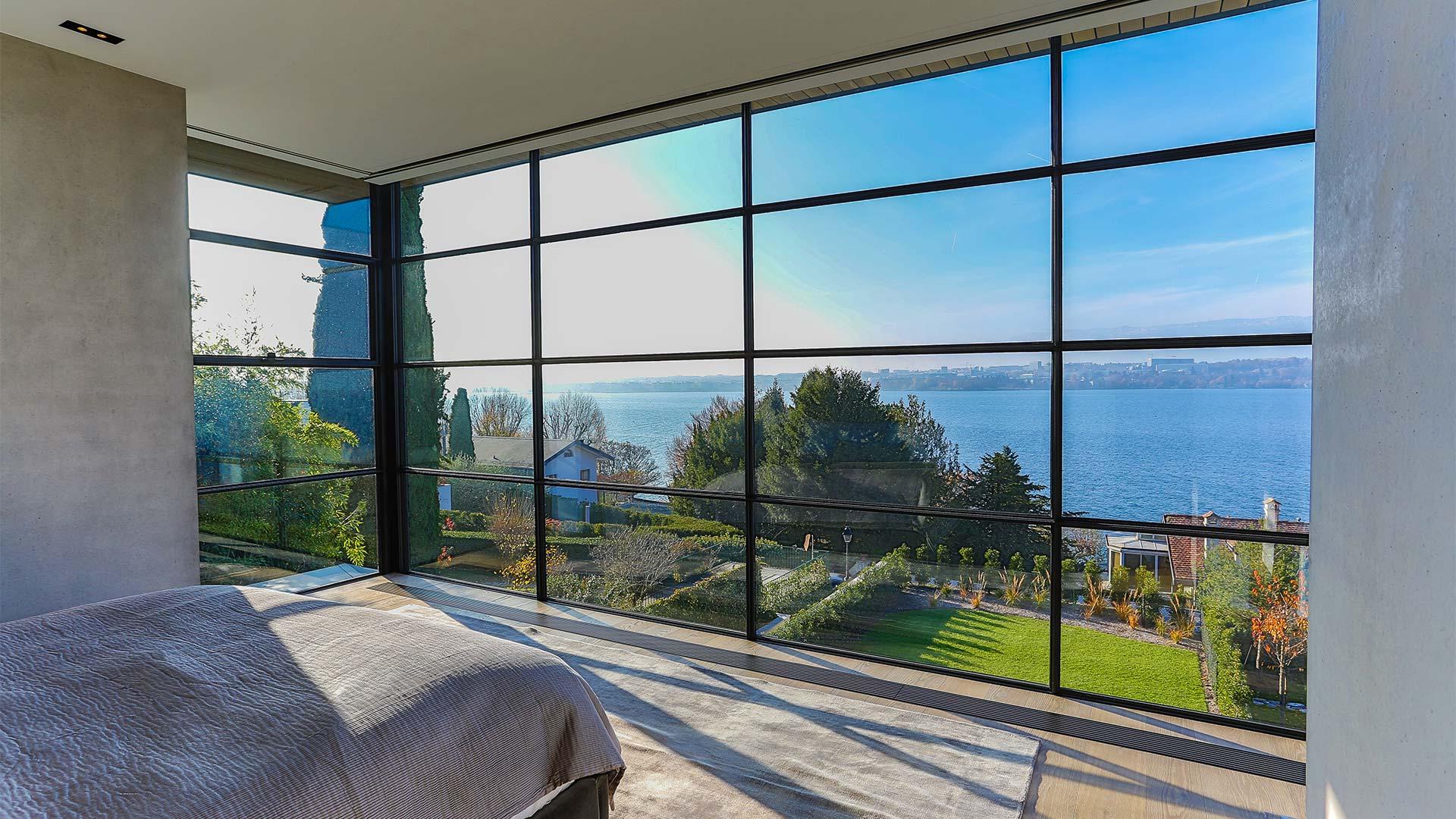 Steel big windows in bedroom