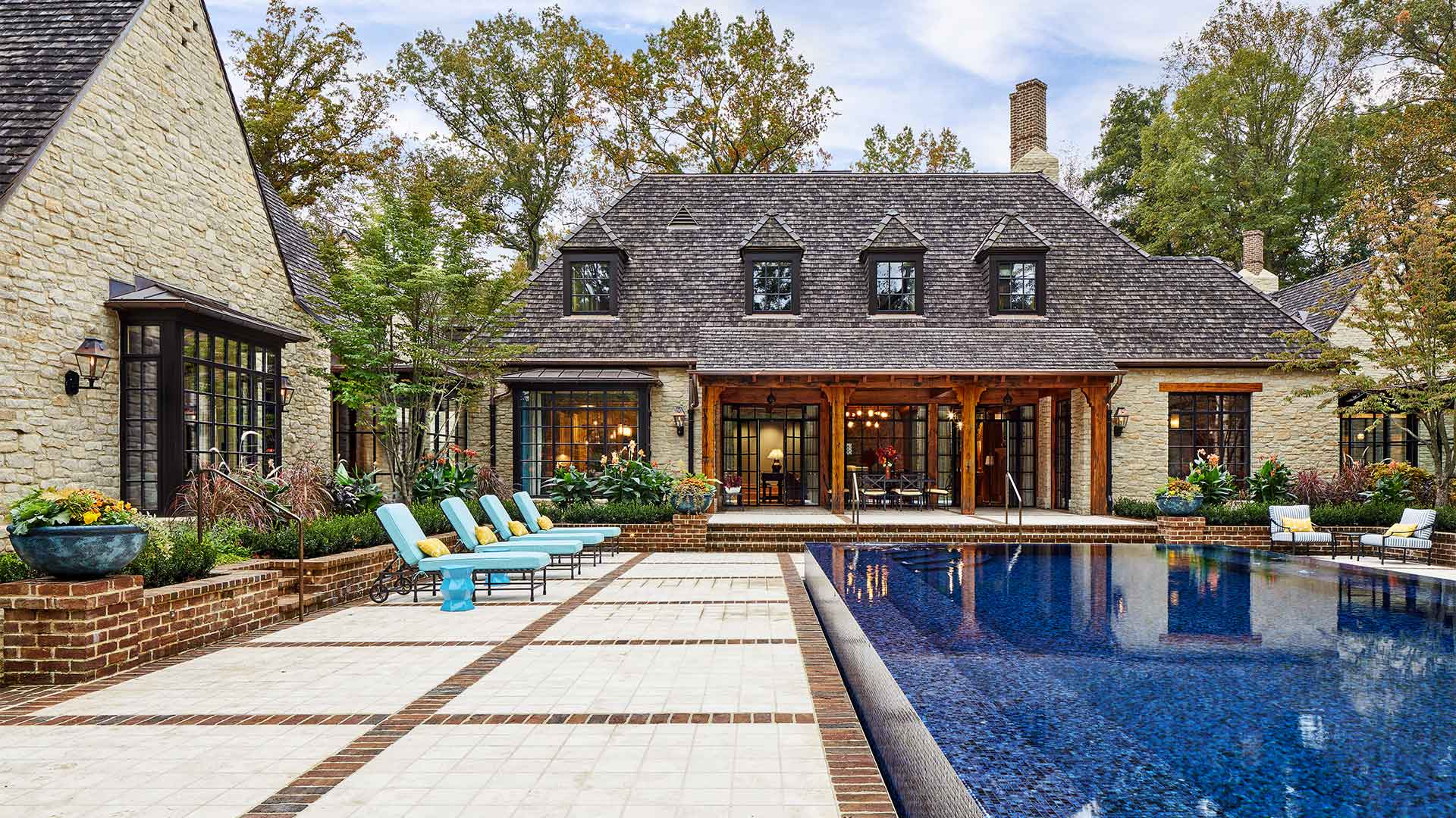 A fancy big house with a pool