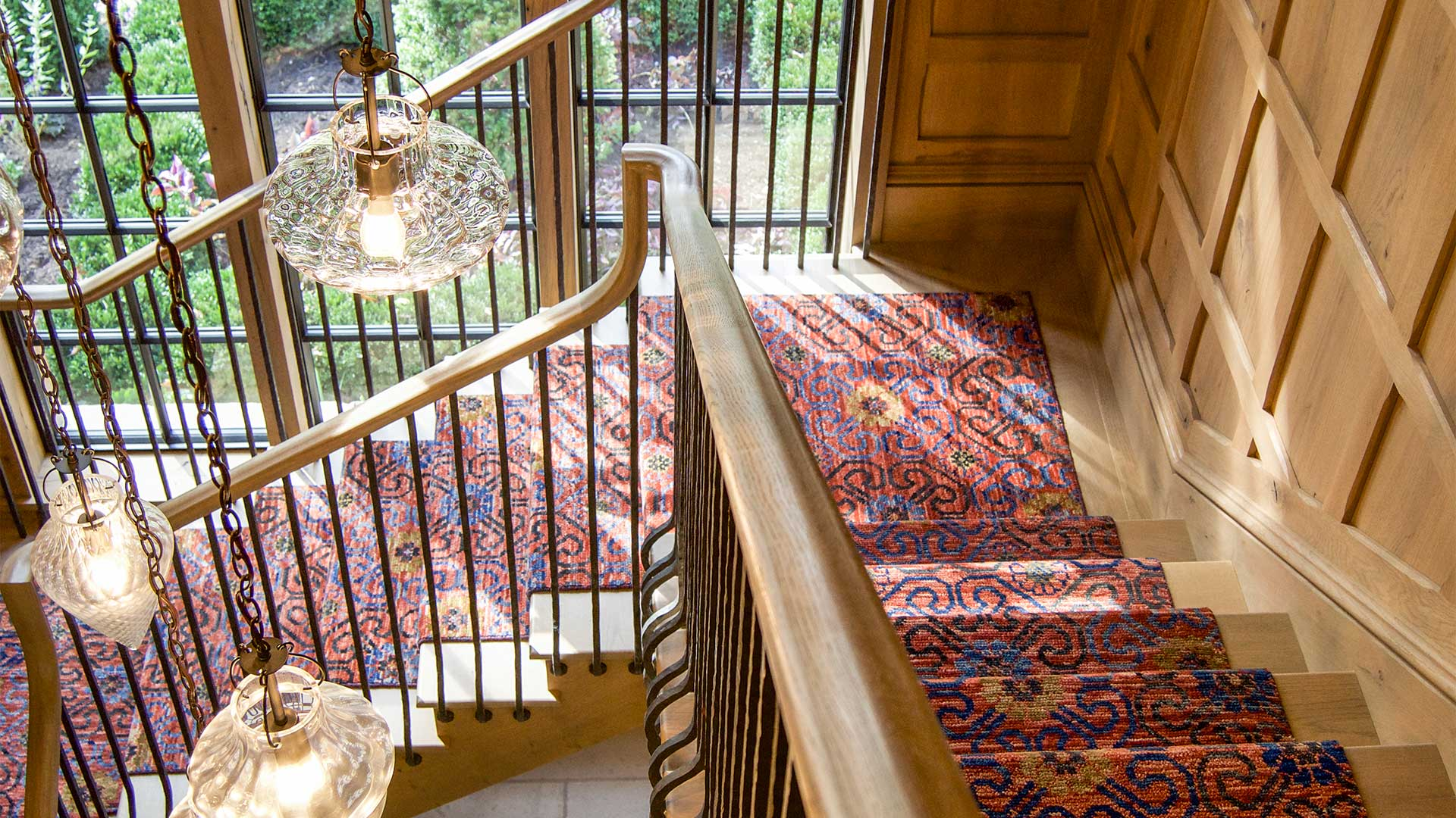 Wooden stairs with carpet and steel windows