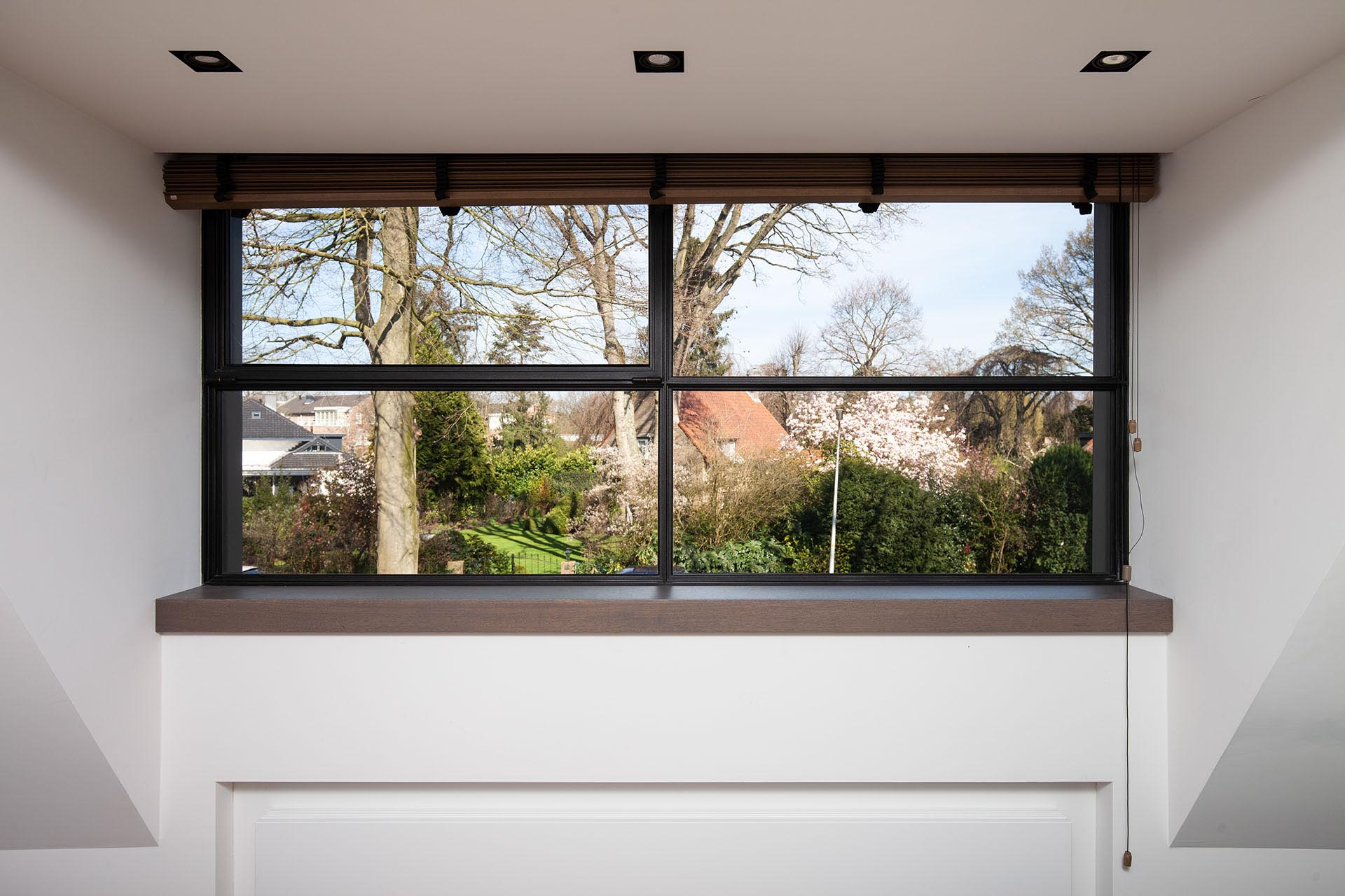 MHB steel awning window overlooking a Dutch village