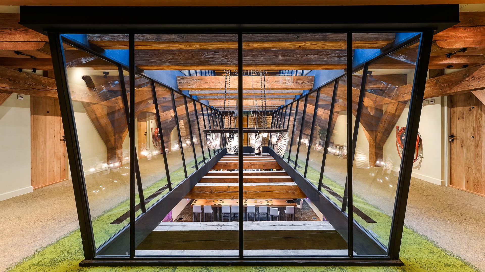 Internal steel glazed partitions at the restaurant het Arsenaal in Woerden, the Netherlands