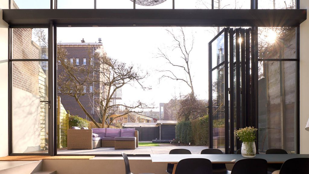 Looking outside in Rotterdam, The netherlands through open MHB folding door