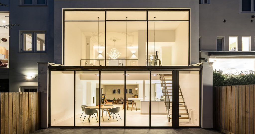 The interior visible through MHB folding doors of a residence in Amsterdam, the Netherlands long