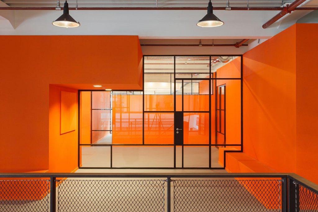 JIP project with bright orange walls and a mondriaan like MHB glazed wall