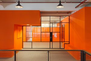 JIP project with bright orange walls and a mondriaan like MHB glazed wall